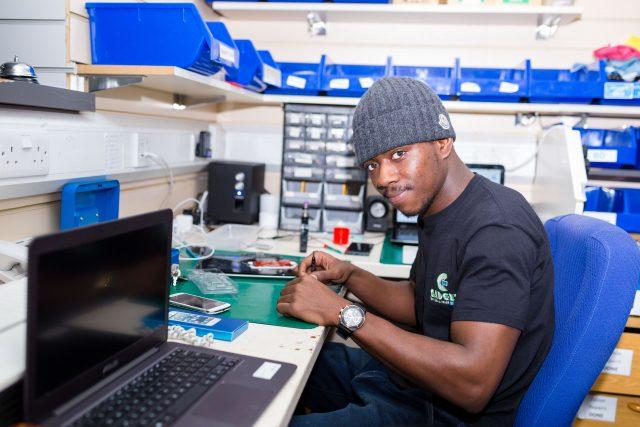 Gadcet repair tech fixing a mobile