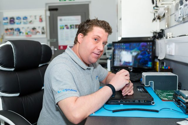 Lee from III IT Solutions opening a laptop